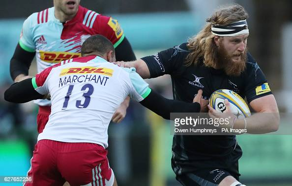 Newcastle Falcons Evan Olmstead gets past Harlequins Joe Marchant during the Aviva Premiership match at Kingston Park Newcastle