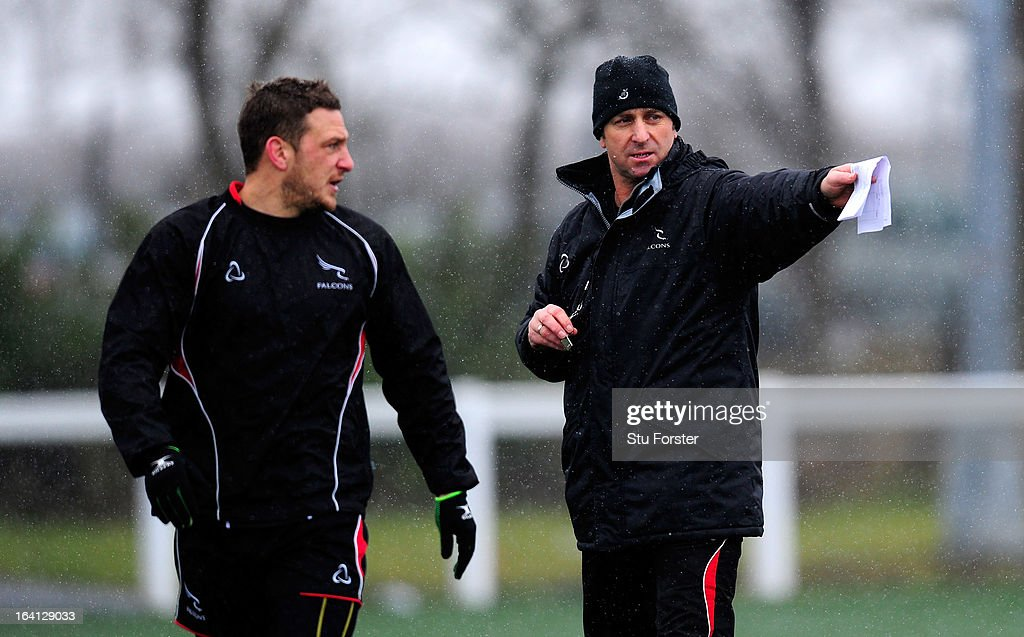 Newcastle Falcons head coach Peter Russell (r) directs training watched by fly half <a gi-track='captionPersonalityLinkClicked' href=/galleries/search?phrase=Jimmy+Gopperth&family=editorial&specificpeople=561375 ng-click='$event.stopPropagation()'>Jimmy Gopperth</a> during Falcons training at Druid Park on March 20, 2013 in Newcastle upon Tyne, England.