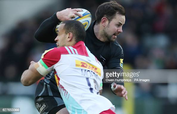 Newcastle Falcons Michael Young is tackled by Harlequins Aaron Moris before scoring his try during the Aviva Premiership match at Kingston Park...