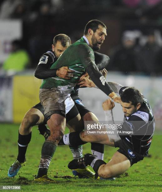 Newcastle Falcon's Ryan Shortland is tackled by Brive's Romain Sola and Thomas Laranerira during the Amlin Challenge Cup Pool Three match at Kingston...