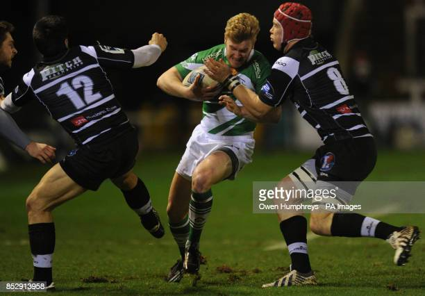 Newcastle Falcon's Tom Catterick is tackled by Brive's Thomas Laranjeira and Kieran Murphy during the Amlin Challenge Cup Pool Three match at...