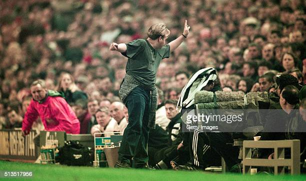 Newcastle fan throws his shirt at manager Kenny Dalglish with the garment landing on the Scots head as Newcastle fall 30 down in the first half of...