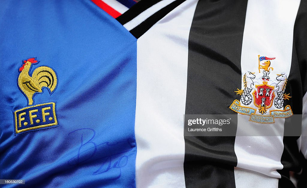 Newcastle fan wears the French and Newcastle shirt joined together during the Barclays Premier League match between Newcastle United and Chelsea at St James' Park on February 2, 2013 in Newcastle upon Tyne, England.