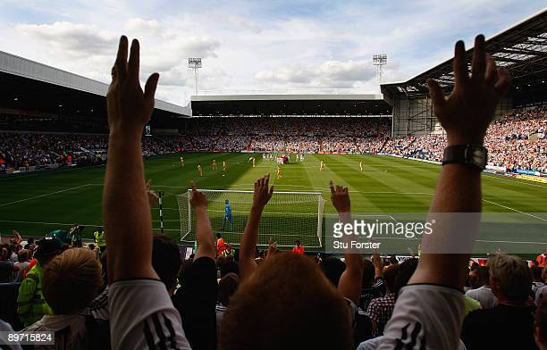 Newcastle fans applaud the memory of Sir Bobby Robson before the Coca Cola Championship game between West Bromwich Albion and Newcastle United at the...