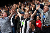 Newcastle fans celebrate victory during the Barclays Premier League match between Newcastle United and West Ham United at St James' Park on May 24...
