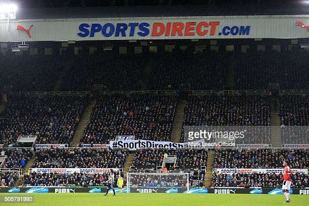 Newcastle fans display a banner aimed at club owner Mike Ashley reading '#SportsDirectShame' during the Barclays Premier League match between...
