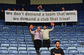 Newcastle fans protest against owner Mike Ashley during the Barclays Premier League match between Leicester City and Newcastle United at The King...