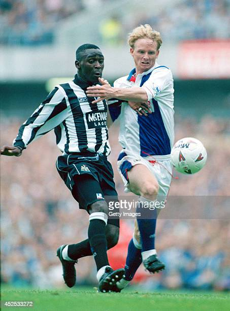 Newcastle forward Andy Cole battles for the ball with David May of Blackburn Rovers in the FA Premier League match between Newcastle United and...