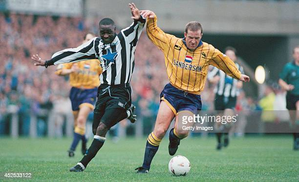 Newcastle forward Andy Cole battles with Peter Atherton during the FA Premiership match between Newcastle United and Sheffield Wednesday at St James'...