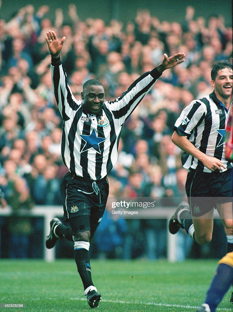 Newcastle forward Andy Cole celebrates after scoring in the FA Premiership match between Newcastle United and Sheffield Wednesday at St James' Park on October 22, 1994, in Newcastle, England.