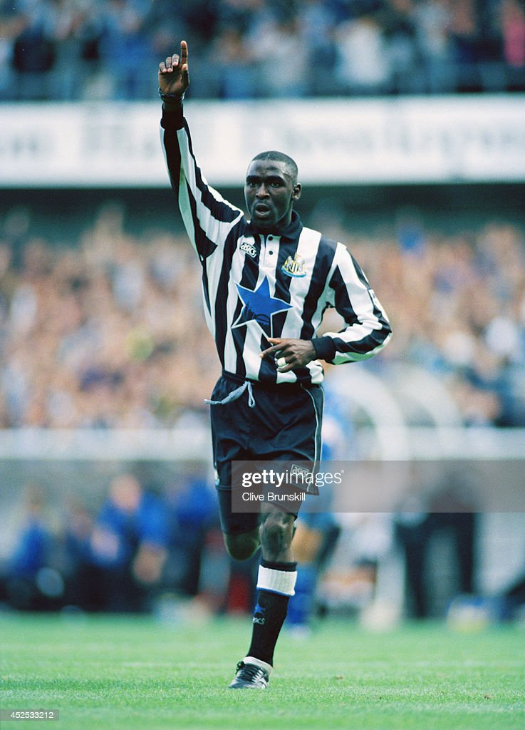 Newcastle forward Andy Cole celebrates after scoring in the FA Premiership match between Newcastle United and Southampton at St James' Park on September 27, 1994, in Newcastle, England.