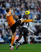 Newcastle forward Demba Ba is challenged by Richard Stearman of Wolves during the Barclays Premier League match between Newcastle United and...