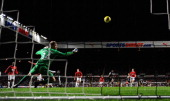 Newcastle forward Demba Ba scores past Man United keeper Anders Lindegaard during the Barclays Premier league game between Newcastle United and...