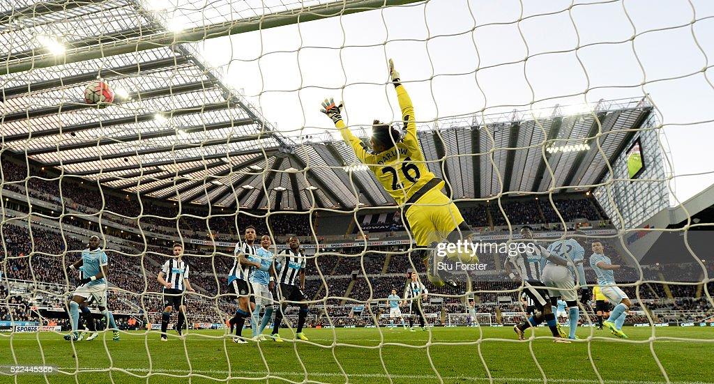 Newcastle goalkeeper Karl Darlow is beaten by a header from Sergio Aaguero (r) for the first goal during the Barclays Premier League match between Newcastle United and Manchester City at St James' Park on April 19, 2016 in Newcastle Upon Tyne, England