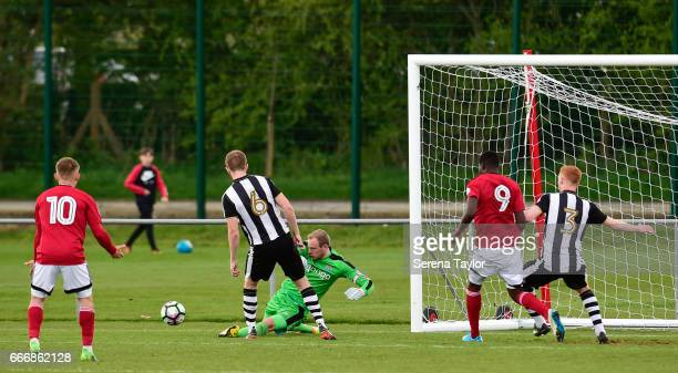Newcastle Goalkeeper Matz Sels slides to make a save with his feet during the Premier League 2 Match between Newcastle United and Fulham at Whitley...