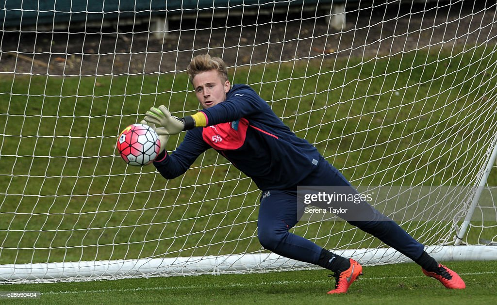 Newcastle goalkeeper Paul Woolston dives to catch the ball during the Newcastle United Training session at The Newcastle United Training Centre on May 6, 2016, in Newcastle upon Tyne, England.