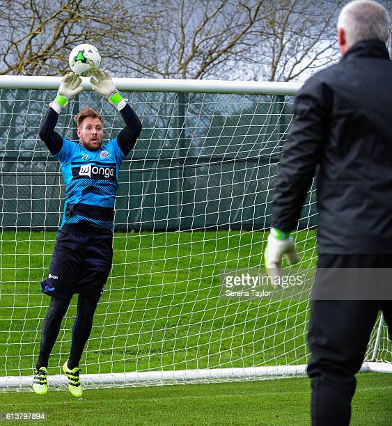 Newcastle Goalkeeper Rob Elliot warms up with Goalkeeping coach Simon Smith as he returns to training at The Newcastle United Training Centre on...