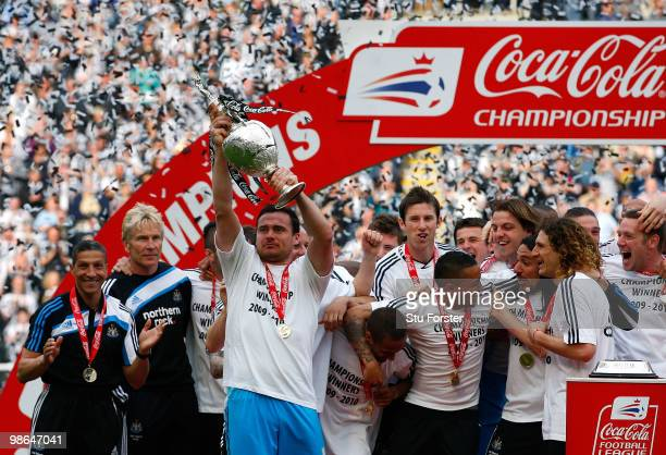 Newcastle goalkeeper Steve Harper lifts the trophy as Newcastle are crowned champions of the Championship after the Coca Cola Championship match...