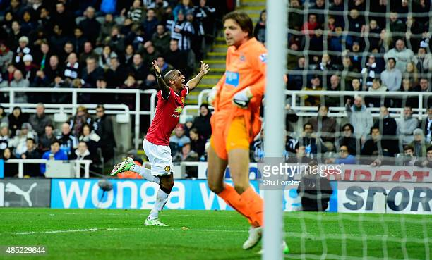 Newcastle goalkeeper Tim Krul reacts as Ashley Young celebrates after scoring the opening goal during the Barclays Premier League match between...