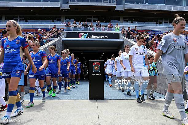 Newcastle Jets and Melbourne Victory players walk out onto Hunter Stadium during the round nine WLeague match between the Newcastle Jets and...