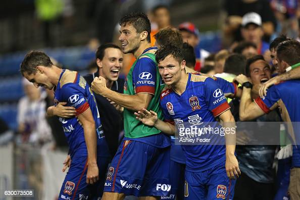 Newcastle Jets celebrate a goal by Morten Nordstrand in extra time to win the game during the round 11 ALeague match between the Newcastle Jets and...