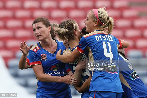 Newcastle Jets celebrate their second goal from Jennifer Hoy during the round 12 WLeague match between the Newcastle Jets and the Brisbane Roar at...