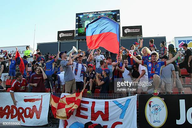 Newcastle Jets fan club support their team during the round 12 ALeague match between the Newcastle Jets and the Wellington Phoenix at McDonald Jones...