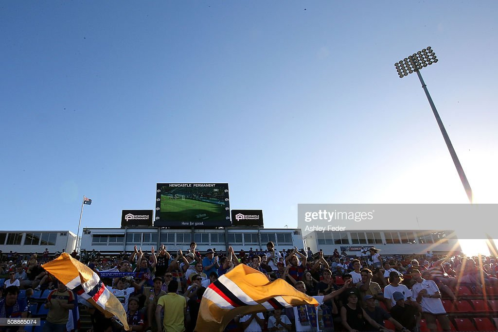 Newcastle Jets fans celebrate the win during the round 18 A-League match between the Newcastle Jets and Melbourne City FC at Hunter Stadium on February 7, 2016 in Newcastle, Australia.