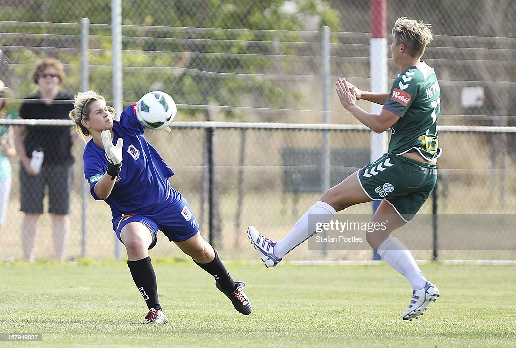 Newcastle Jets goal keeper Eliza Campbell stops a shot on goal by Michelle Heyman of Canberra United during the round eight W-League match between Canberra United and the Newcastle Jets at Deakin Football Stadium on December 8, 2012 in Canberra, Australia.
