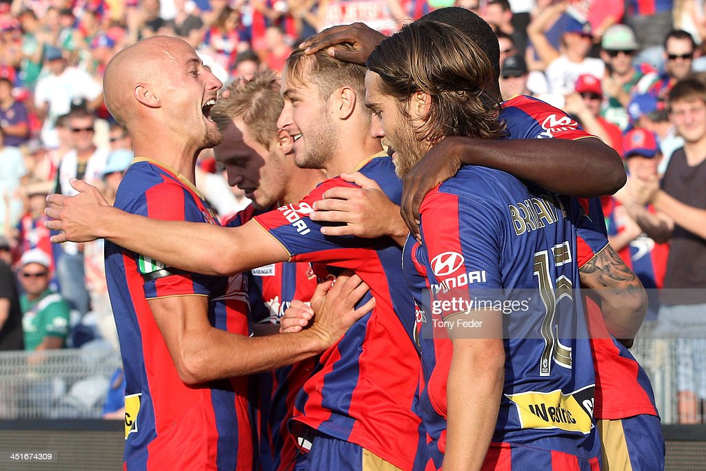 Newcastle Jets players celebrate a goal during the round seven A-League match between the Newcastle Jets and the Melbourne Heart at Hunter Stadium on November 24, 2013 in Newcastle, Australia.