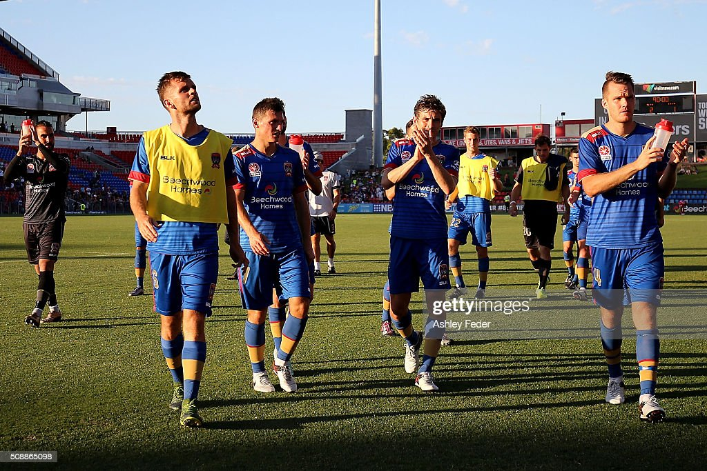 Newcastle Jets players celebrate the win during the round 18 A-League match between the Newcastle Jets and Melbourne City FC at Hunter Stadium on February 7, 2016 in Newcastle, Australia.