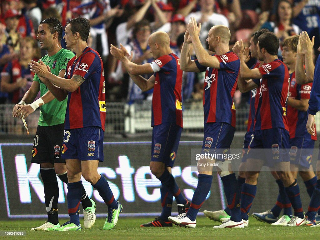 Newcastle Jets players celebrate with the fans after winning the round 16 A-League match between the Newcastle Jets and the Brisbane Roar at Hunter Stadium on January 12, 2013 in Newcastle, Australia.