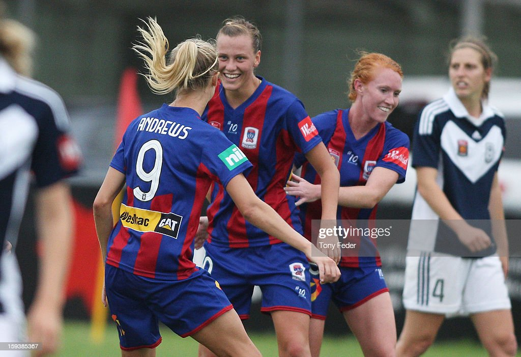 Newcastle Jets players L-R Tara Andrews <a gi-track='captionPersonalityLinkClicked' href=/galleries/search?phrase=Emily+Van+Egmond&family=editorial&specificpeople=4667782 ng-click='$event.stopPropagation()'>Emily Van Egmond</a> and Tori Huster celebrate a goal during the round 12 W-League match between the Newcastle Jets and the Melbourne Victory at Wanderers Oval on January 13, 2013 in Newcastle, Australia.