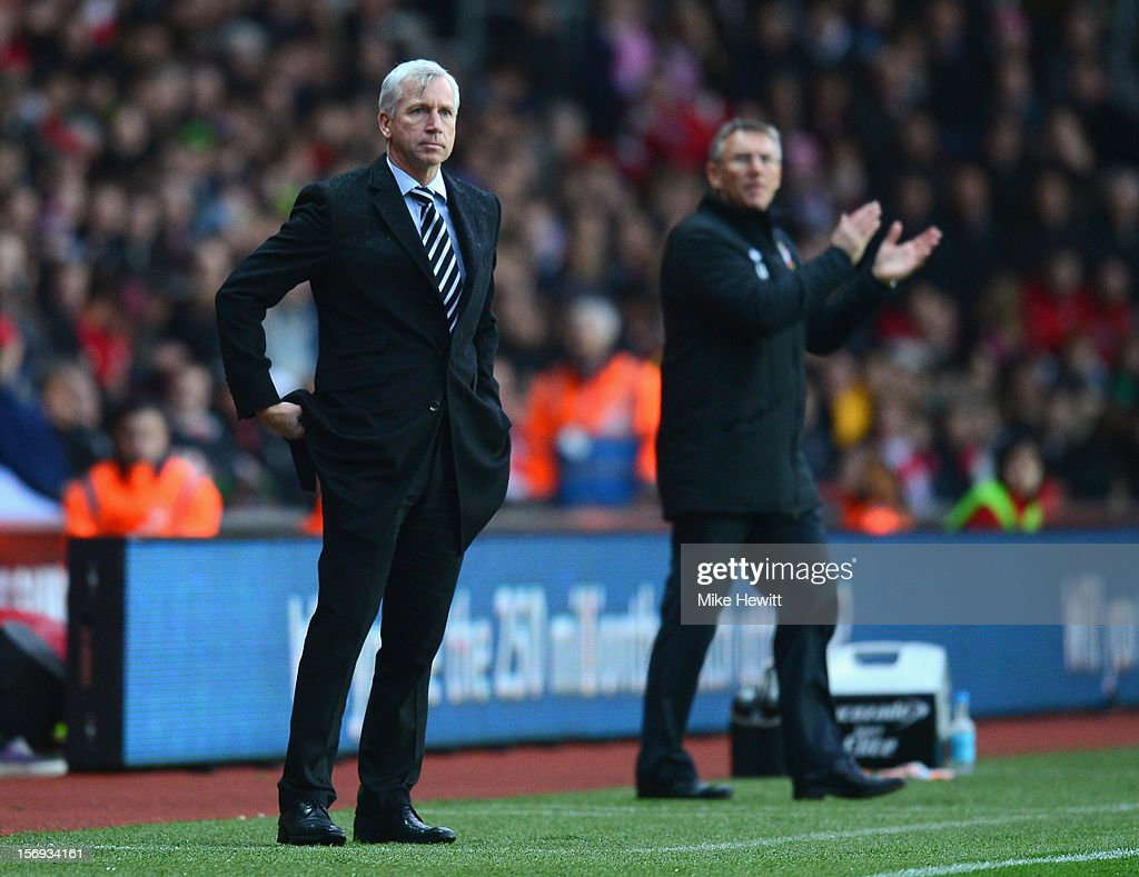 Newcastle manager Alan Pardew and Southampton manager Nigel Adkins look on during the Barclays Premier League match between Southampton and Newcastle United at St Mary's Stadium on November 25, 2012 in Southampton, England.