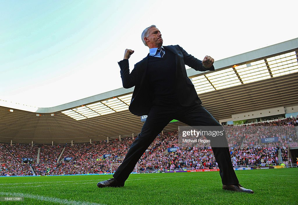 Newcastle manager Alan Pardew celebrates after his team's goal during the Barclays Premier League match between Sunderland and Newcastle United at the Stadium of Light on October 21, 2012 in Sunderland, England.