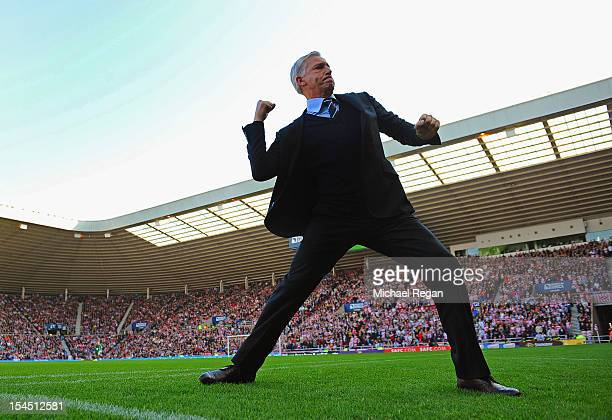 Newcastle manager Alan Pardew celebrates after his team's goal during the Barclays Premier League match between Sunderland and Newcastle United at...