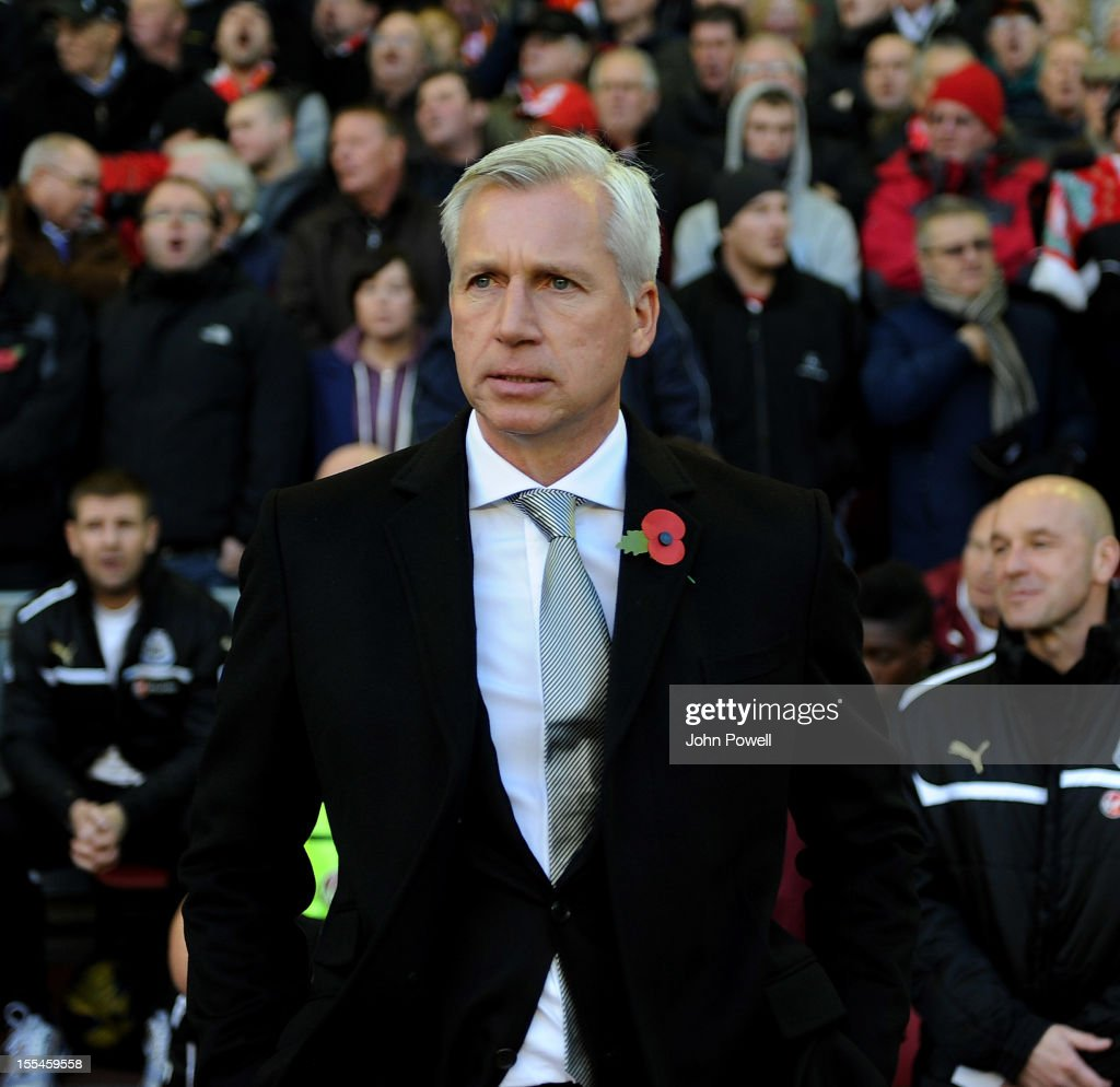 Newcastle manager Alan Pardew looks on before the kick off of the Barclays Premier League match between Liverpool and Newcastle United at Anfield on November 4, 2012 in Liverpool, England.