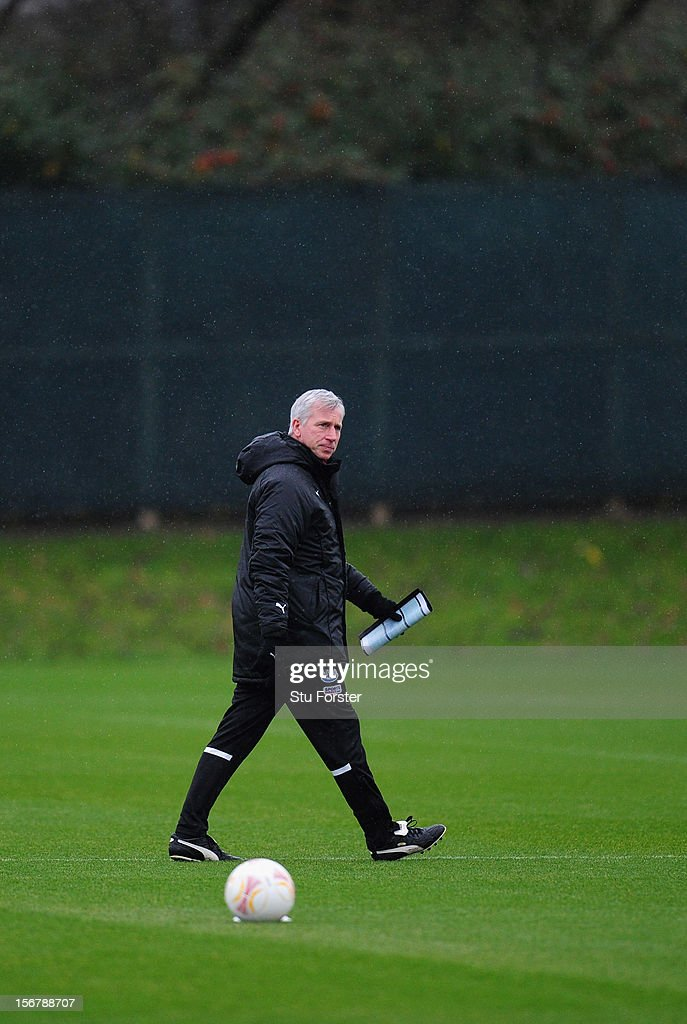 Newcastle manager Alan Pardew looks on during Newcastle United training ahead of thursday's UEFA Europa League match against Maritimo at The Little Benton training ground on November 21, 2012 in Newcastle upon Tyne, England.