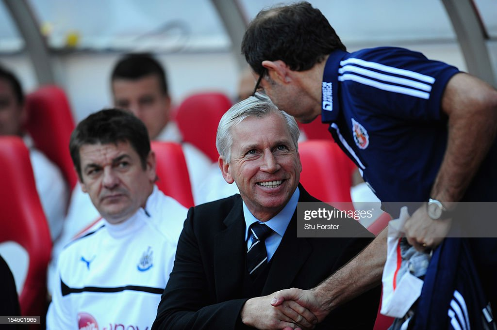 Newcastle manager <a gi-track='captionPersonalityLinkClicked' href=/galleries/search?phrase=Alan+Pardew&family=editorial&specificpeople=171147 ng-click='$event.stopPropagation()'>Alan Pardew</a> (l) shakes hands with Sunderland boss Martin O' Neill before the Barclays Premier league match between Sunderland and Newcastle United at Stadium of Light on October 21, 2012 in Sunderland, England.