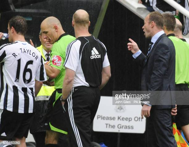 Newcastle Manager Alan Shearer gestures as he talks to referee Howard Webb as he leaves the pitch following during the Barclays Premier League match...