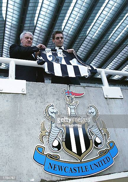 Newcastle manager Bobby Robson and new signing Jonathan Woodgate pose for photgraphers after a press conference at St James Park on January 31 2003...
