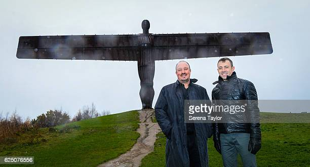 Newcastle Manager Rafael Benitez and Assistant Manager Francisco De Miguel Moreno pose for a photograph at a very wet and windy Angel of the North...