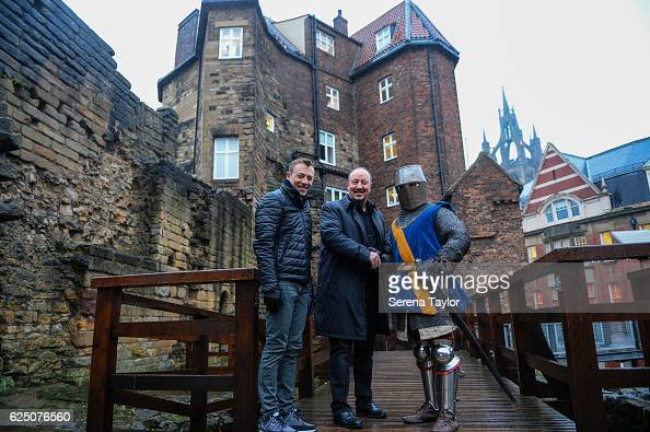 Newcastle Manager Rafael Benitez and Assistant Manager Francisco De Miguel Morenois are greeted by a swordsman at Newcastle Castle during a visit to...