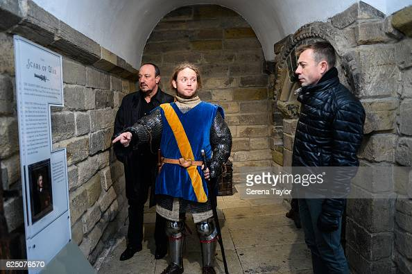 Newcastle Manager Rafael Benitez and Assistant Manager Francisco De Miguel Moreno speak to a tour guide dressed as a swordsman whilst at the Castle...