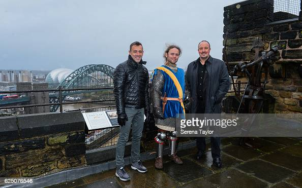 Newcastle Manager Rafael Benitez Assistant Manager Francisco De Miguel Moreno pose for a photograph with a tour guide dressed as a swordsman on the...