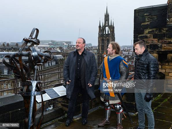 Newcastle Manager Rafael Benitez Assistant Manager Francisco De Miguel Moreno speak to a tour guide dressed as a swordsman on the roof of the Castle...