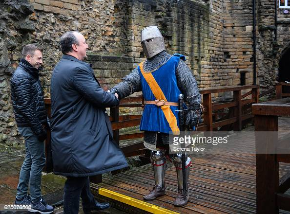 Newcastle Manager Rafael Benitez is greeted by a swordsman at Newcastle Castle during a visit to landmarks in the North East of England on November...