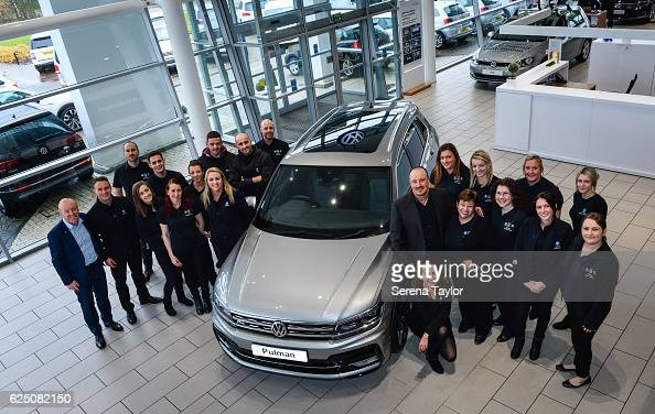 Newcastle Manager Rafael Benitez poses for a photograph at Pulman Volkswagen with staff members whilst visiting some of the North East of England...