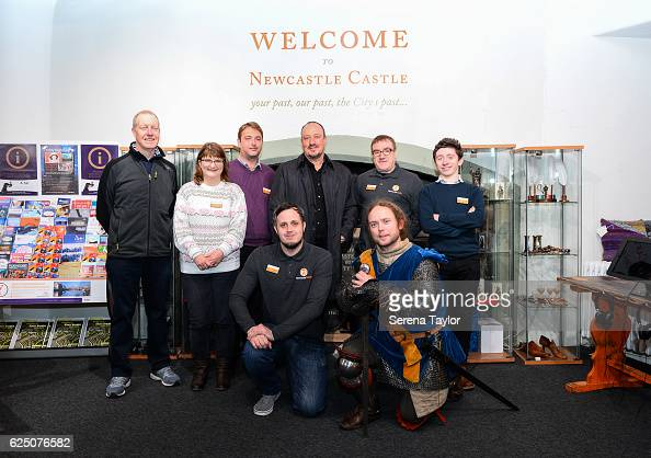 Newcastle Manager Rafael Benitez poses for a photograph with staff members at Newcastle Castle during a visit to landmarks in the North East of...