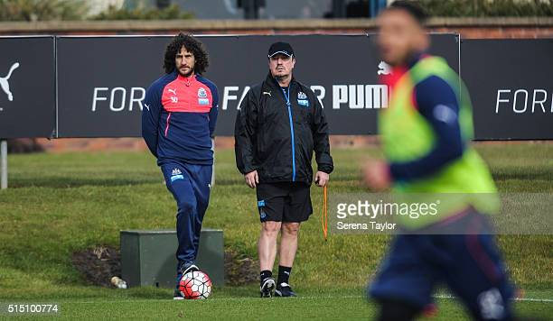 Newcastle Manager Rafael Benitez stands on the sidelines with Captain Fabricio Coloccini during the Newcastle United training session at The...